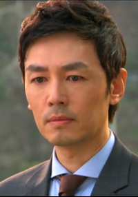 Jo Yeon Woo looks haunted and stressed as his plot starts to unravel;