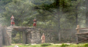 Guards stand atop a stone wall at the rebel hideout