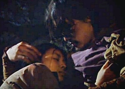 Jang Sung Baek looks down at the sleeping damo in his arms and caresses her hair