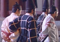 Hwangbo and Chief Joh are escorted to the jail by guards in conical hats;
