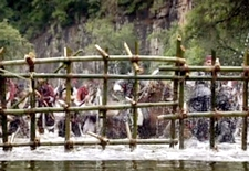Spiked bamboo walls rise out of the river to entrap Commander Joh's men;