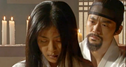 Hwangbo ties back the damo's hair looking anguished as he prepares to deliver a killing blow that may revive or kill her;