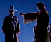 Jang Sung Baek holds out the bloodstained Japanese sword to the Lord;