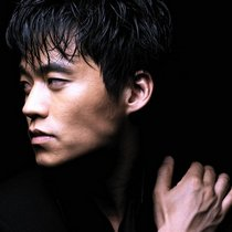 Early headshot of Lee Seo Jin against a dramatic black background