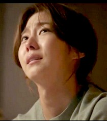An anguished Hye Soo looks heavenward as she pleads that she still has a lot to do in life