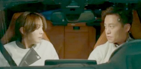 Hye Soo and Ji Hoon exchange a meaningful glance in the front seat of his car after she prevents his mother from killing herself