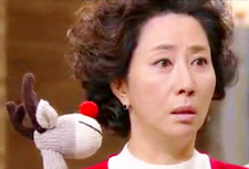 Song Ok Sook looks horrifed as Ho Jeong shows her a stuffed reindeer