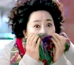 Ho Jeong's mother covers her mouth with a scarf to disguise her identity  as she spies on Ho Jeong and Sang Woo