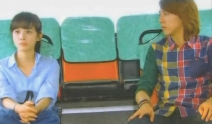 Sung Jae looks yearningly across the aisle of a bus at Seoyeong;
