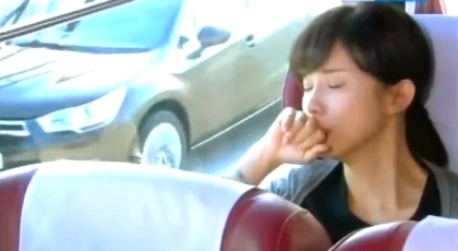 Seoyoung weeps on the bus, while Ujae's SUV hovers just outside her window;