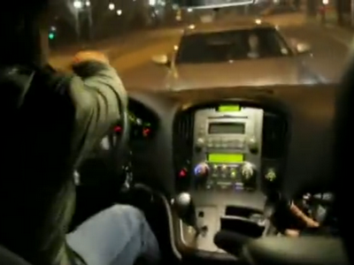 Looking out Detective Hwang's windshield at Detective Yoo's car blocking his way