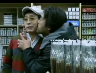 Hwang kisses the art supply shop owner on the cheek