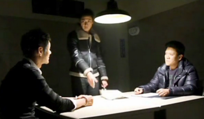 Prosecutor Min in the interrogation room with his friend and a police detective