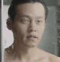 Lee Seo Jin stares into a mirror in a steamy bathroom thinking about the woman he loves