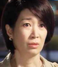 Na Young Hee with a very unhappy expression on her face;