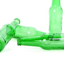 Several empty green bottles