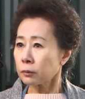Yoon Yeo Jung with a very unhappy expression on her face;