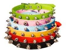 A stack of different colored leather bracelets with spikes