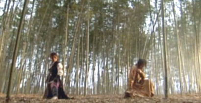 Ha Ji Won and Kim Min Joon crouch back to back on the floor of a bamboo forest;
