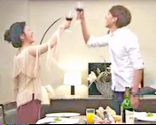 Seoyoung My Daughter Epsiode 29 - Sung Jae and his mom raise wine glasses to toast to freedom in the dining room of their upscale hotel suite