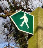 Sign that show a figure walking